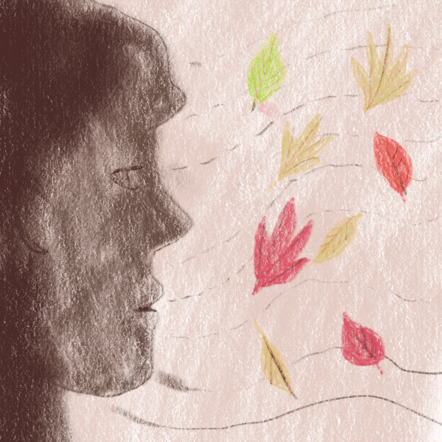 profile of person staring at leaves blowing in the wind