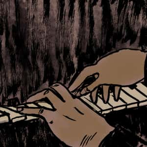 close-up of two black hands playing the piano
