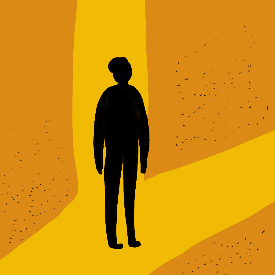 illustrated silhouette of a person standing at a fork in the road